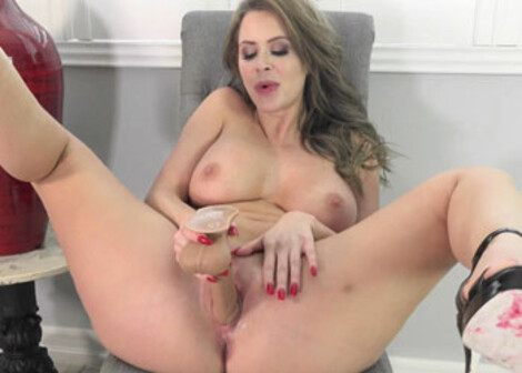 Emily Addison sticks a dong in her wet pussy